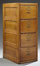 American Carved Oak Four Drawer Legal Size Filing Cabinet, early 20th c., with paneled sides, H.- 51 3/4 in., W.- 20 1/4 in., D.- 27...