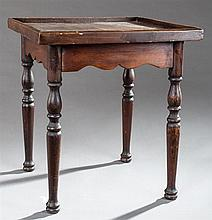 French Provincial Carved Walnut Lamp Table, 19th c., the galleried top