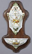 Italian Provincial Majolica Lavabo, 20th c., with fruit and floral decoration, on a carved mahogany back plate, H.- 35 1/2 in., W.-...