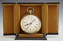 Large Brass Desk Clock, 20th c., by Lancel, in the form of a pocket watch, with a quartz movement, in original leatherette case, H.-...