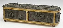 French Bronze and Patinated Spelter Dresser Box, late 19th c., by T&E Paris, the sides and arched top with relief scenes of country...