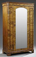 English Victorian Burled Walnut Armoire, c. 1880, the reeded ogee crown over a central arched beveled mirror door, flanked on one si...