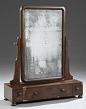 English Carved Mahogany Dressing Mirror, early 19th c., with a rectangular mirror on shaped supports on a base with three drawers, o...