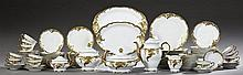 Eighty-Four Piece Set of Polish Porcelain Dinnerware, 20th c., by Wawel, with gilt leaf decoration, consisting of 12 dinner plates,...