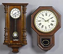 Two Mahogany Wall Clocks, late 19th c., one by Seth Thomas, a schoolhouse calendar clock; the second German with an enamel dial with...