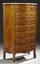 Louis XV Style Marble Top Ormolu Mounted Bombe Mahogany Semainier, 20th c., with a shaped orange marble, over seven inlaid drawers w...