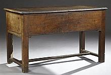 French Provincial Carved Oak Dough Trough (Petrin), mid 19th c., the stepped curved corner hinged lid over open storage, on square l...