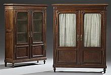 Pair of French Louis XVI Style Carved Oak Bookcases, 20th c., the stepped crown over double doors with brass panels, above lower fie...