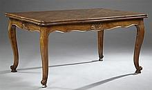 Louis XV Style Carved Walnut Draw Leaf Table, 20th c., with a parquetry inlaid top, over a shell carved shaped skirt, on cabriole le...