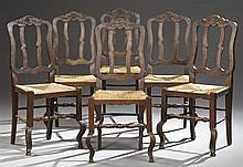 Set of Six French Provincial Louis XV Style Dining Chairs, 19th c., with arched crest rails centered by a floral medallion, over a s...