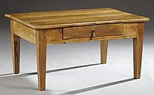 French Provincial Carved Cherry Side Table, 19th c., the three plank top over a frieze drawer and wide skirt, on tapered square legs...