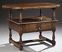 French Provincial Louis XIII Style Carved Oak Two Tier Server, 19th c., the oval shaped three plank top on turned tapered supports,...