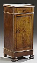 Louis Philippe Carved Walnut Marble Top Nightstand, 19th c., the inset canted corner white marble over a frieze drawer and a long cu...
