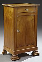 French Louis Philippe Carved Cherry Nightstand, mid 19th c., the two plank top over a single drawer and crotched cupboard door with ...