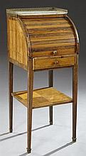Louis XVI Style Fruitwood Bedside Cupboard, early 19th c., the three quarter brass galleried marble top above a tambour roll top cup...