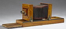 French Carved Cherry Studio Bellows Camera, 19th c., for a 5 x 7 plate, with an Aplanascope 13 x 18 brass lens, by A. J Pipon, on a ...