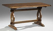 French Provincial Carved Elm Refectory Table, 20th c., the rectangular top on pierced lyre trestle supports joined by a rectangular...