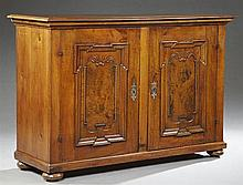 French Louis XIII Style Carved Cherry Sideboard, 19th c. and later, the rectangular inset pine top over two cupboard doors with inse...