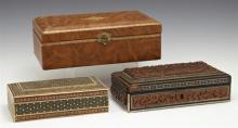Group of Three Dresser Boxes, 20th c., one of gilt tooled leather and two Moroccan with elaborate mosaic inlay, Leather- H.- 3 in.,...