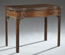 Chippendale Style Carved Mahogany Games Table, c. 1900, the serpentine top with cookie corners opening over rear pull-out supports a...