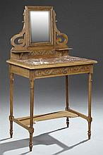 French Art Nouveau Louis XVI Style Pressed Beech Marble Top Vanity, late 19th c., the wide beveled rectangular mirror over two candl...