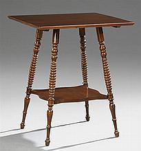 American Victorian Mahogany Lamp Table, c. 1900, on turned splayed legs joined by a lower shaped shelf, H.- 28 1/2 in., W.- 24 in.,...