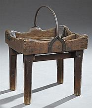 French Provincial Carved Oak and Iron Blacksmith's Workbox on Stand, mid 19th c., the arched horse shoe form handle over a compartme..