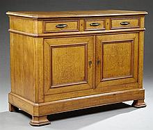 French Louis Philippe Carved Oak Sideboard, 19th c., the canted corner rectangular top over three frieze drawers above two cupboard...