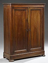 French Provincial Louis Philippe Carved Walnut Cabinet, 19th c., the rectangular canted corner top over two cupboard doors flanked b...