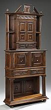 French Renaissance Style Carved Oak Parlor Cabinet on Stand, 20th c., the breakfront dentillated stepped crown above double cupboard...