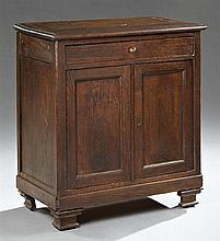 French Provincial Louis XIV Style Carved Oak Confiturier, 19th c., the stepped edge rectangular top over a frieze drawer above two c...