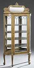 American Victorian Carved Oak Curved Glass Display Cabinet, c. 1900, the arched beveled mirror crest over a glazed door with leaded...