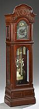 Georgian Style Carved Mahogany Tall Case Clock, 20th c., by Harrington House, Westminster chimes, the arched crest over an arched do...