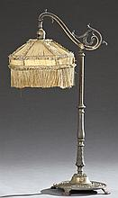 American Cast Iron Table Lamp, early 20th c., with a relief decorated arm, on a knopped relief support to a relief circular base on...