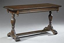 American Renaissance Style Carved Birch Library Table, c. 1940, the rectangular stepped top over a frieze drawer on two turned flute...