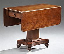 American Classical Carved Mahogany Drop Leaf Table, late 19th c., the rectangular top over an end drawer, on a tapered square suppor...