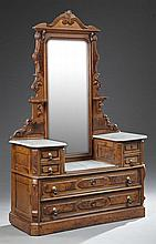 American Eastlake Carved Walnut Marble Top Dropwell Dresser, late 19th c., the arched crest over a rectangular mirror flanked by can...