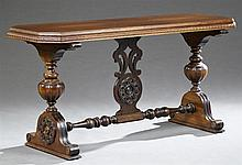 American Walnut Console Table, c. 1915, the rectangular canted corner stepped edge top on two fluted carved baluster urn trestle sup...