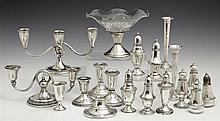 Group of Nineteen Miscellaneous Sterling Pieces, consisting of 9 salt and pepper shakers, a liqueur, 3 low candlesticks, 2 bud vases...