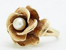 Lady's 14K Yellow Gold Floriform Dinner Ring, with a central 5 mm white cultured pearl, mounted on a split band, size 5 3/4, Wt.- .3..