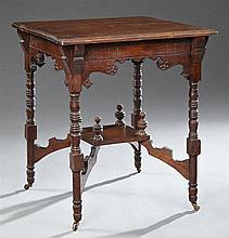 American Eastlake Carved Oak Lamp Table, c. 1900, the square top over an incised skirt, on ring turned legs to turned feet on caster...