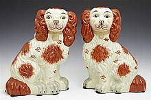 Pair of Staffordshire Style Seated Dogs, 20th c., H.- 12 1/4 in., W.- 9 in., D.- 4 3/4 in.
