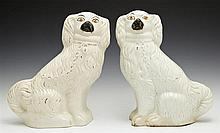 Pair of Staffordshire Dogs, 19th c., with original paint and traces of original gilt decoration, H.- 10 3/4 in., W.- 9 1/2 in., D.-...