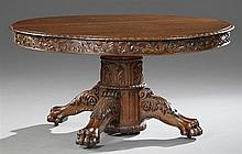 American Victorian Jacobean Style Carved Oak Paw Foot Banquet Table, late 19th c., attributed to Hastings Table Co., the circular to...