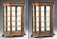 Pair of American Jacobean Style Carved Oak Curved Glass Curio Cabinets, 19th c., attributed to Hastings Chair Co., the breakfront st...