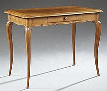 French Provincial Louis XV Style Carved Cherry Writing Table, early 20th c., the serpentine rectangular stepped edge top over a frie...