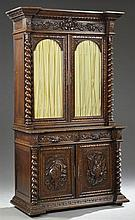 French Jacobean Style Carved Oak Buffet a Deux Corps, 19th c., the stepped crown over two arched glazed cupboard doors flanked by ba...