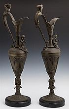 Pair of Ornate Patinated Spelter Ewers, c. 1880, with a relief female handles and putti mount over a Bacchus masque, on a tapered re...