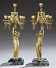 Pair of French Empire Style Six Light Figural Candelabra, 19th c., with a central candle arm atop five relief scrolling arms, suppor...