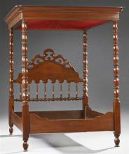 American Late Victorian Carved Walnut Full Tester Double Bed, late 19th c., the stepped tester on ring turned posts, joining a serpe...